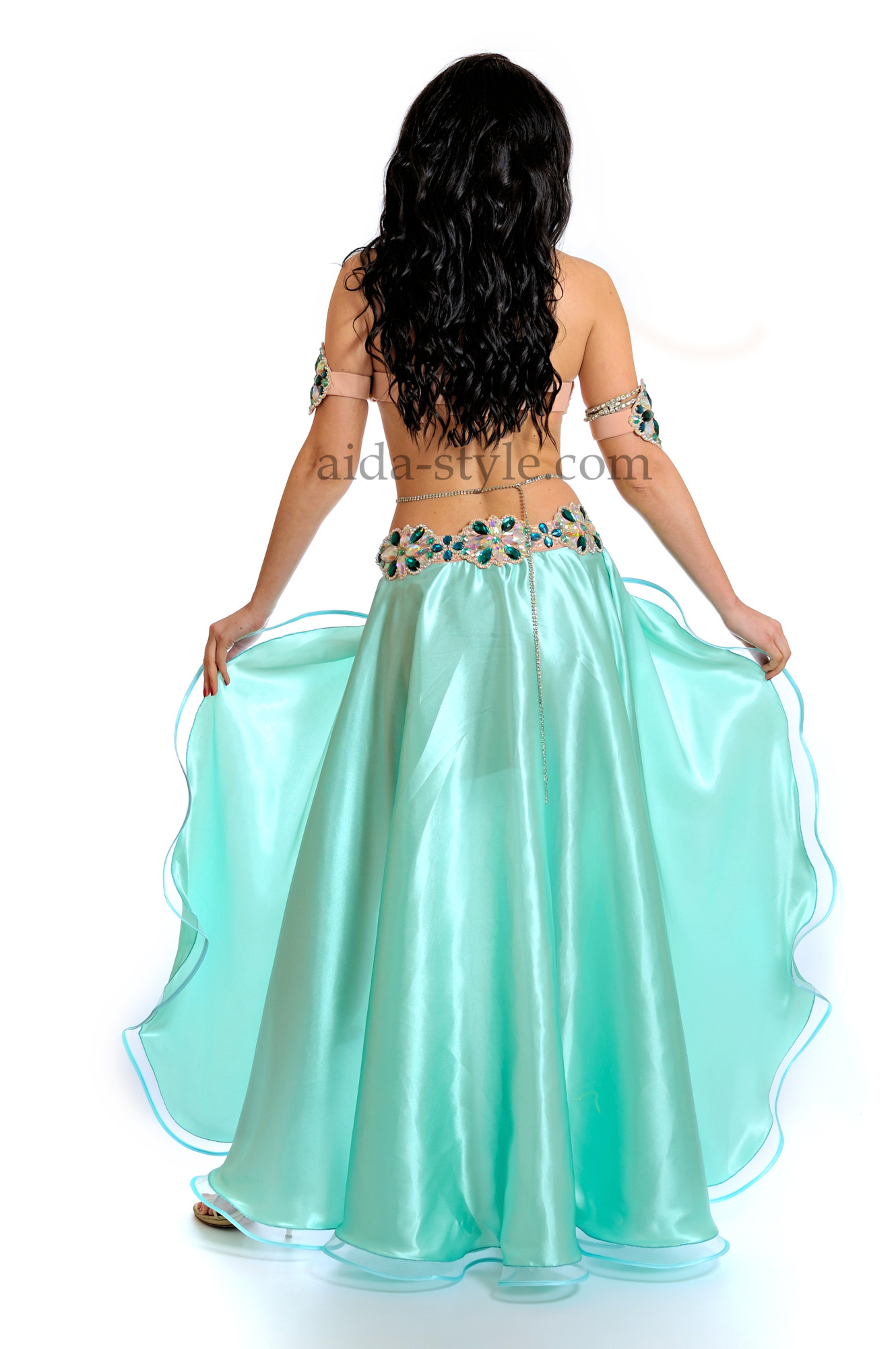 Professional belly dance costume in azure-blue color with bra and belt decorated with blue stones. The skirt consist of a mini-skirt and floor-length second level