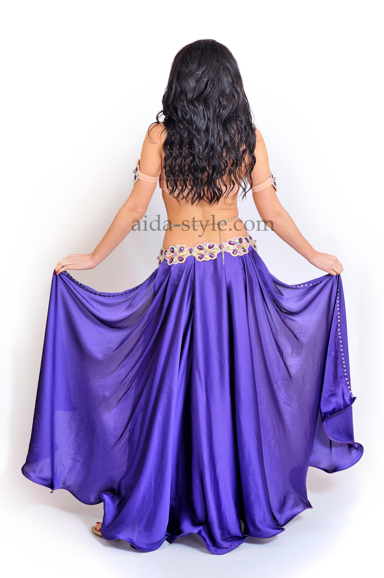 Professional belly dance costume in bright blue color with cut on both sides of the skirt and blue stones on bra and belt