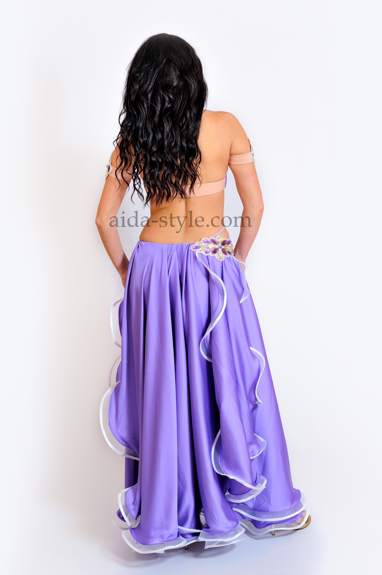 Bright lilac professional belly dance costume with flowers from stones on the right hip and on the bra