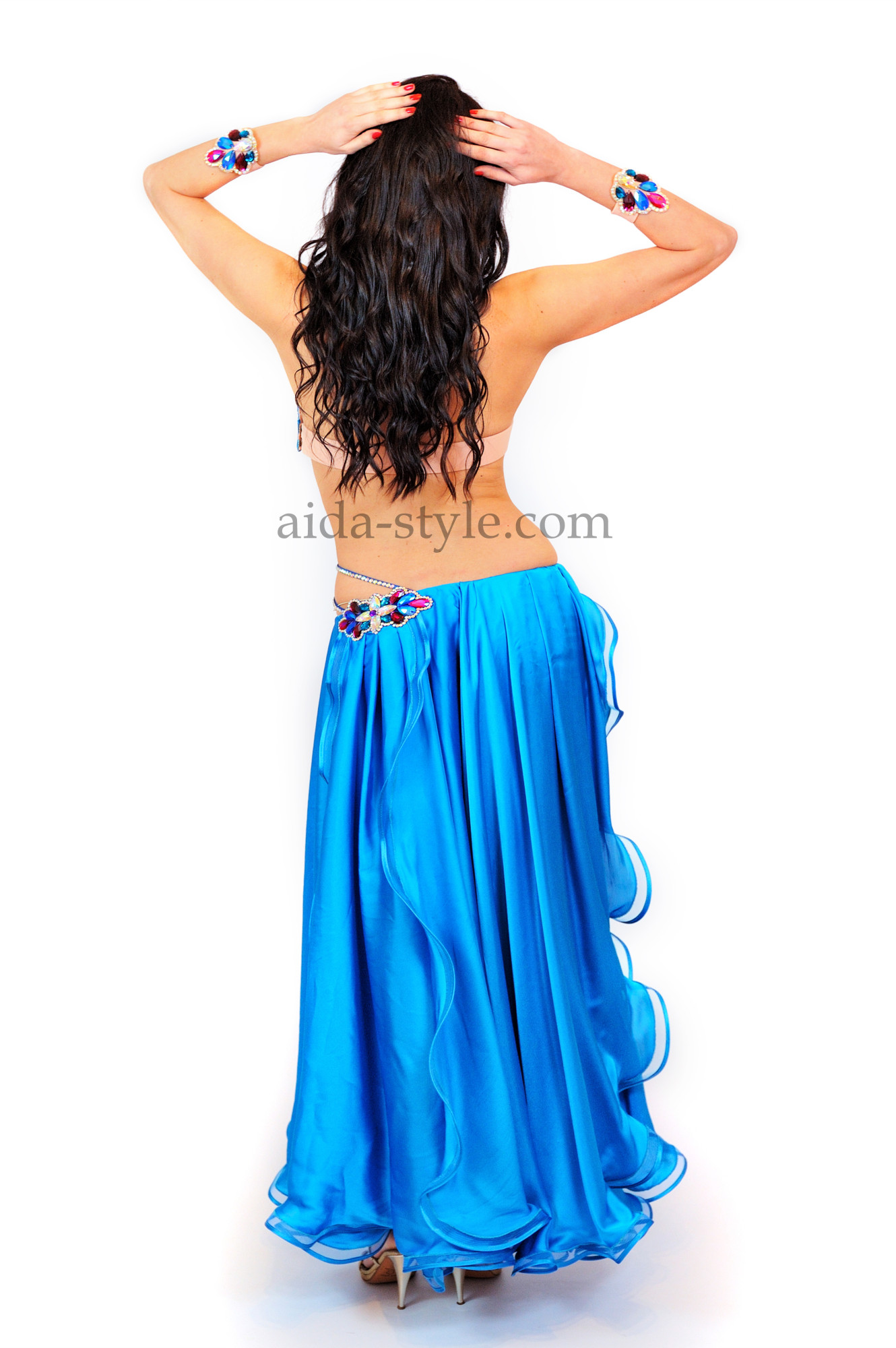 Bright blue professional belly dance costume with flowers from stones on the right hip and on the bra