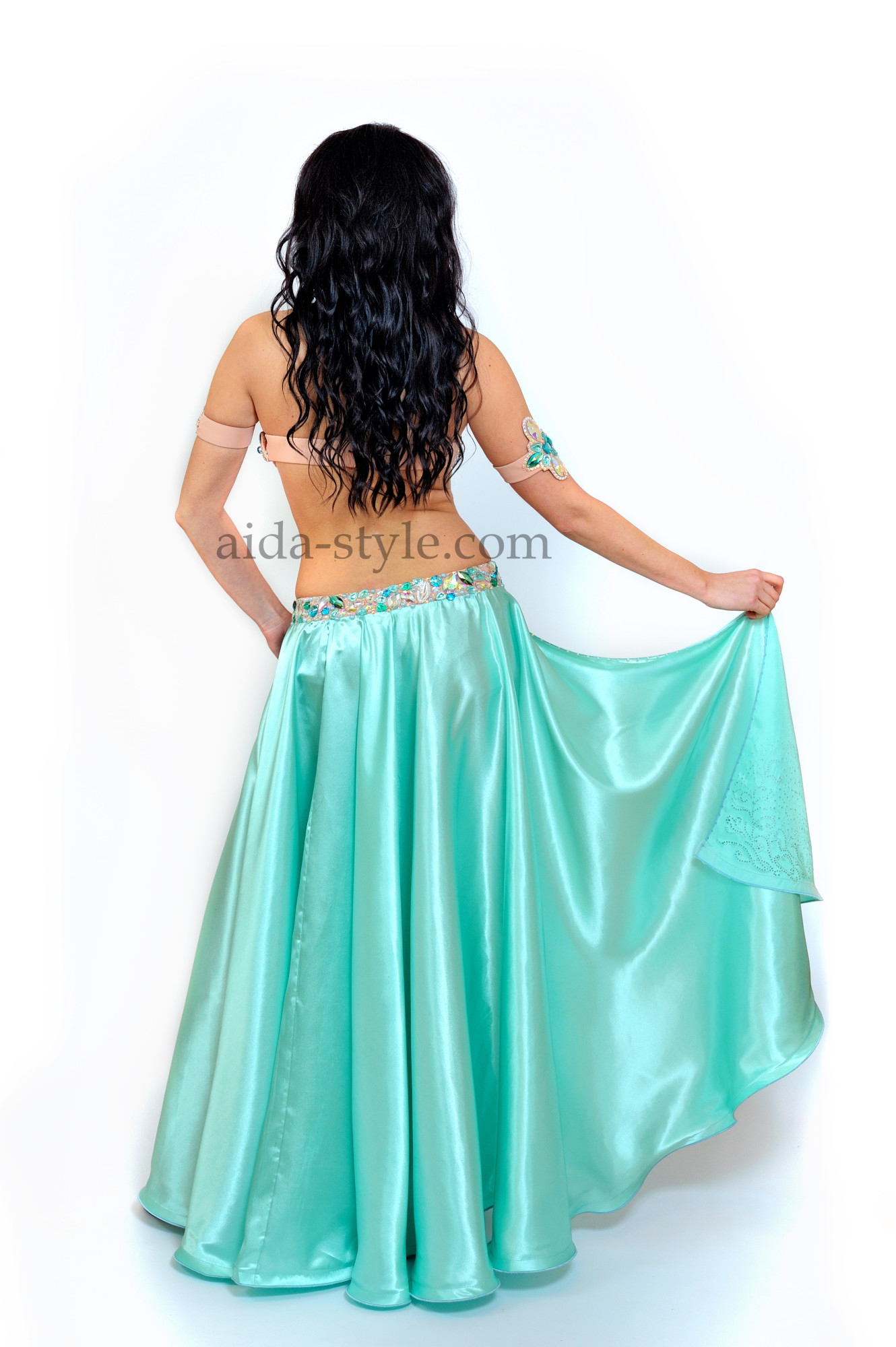 Professional belly dance costume in azure-blue color with long bouffant skirt