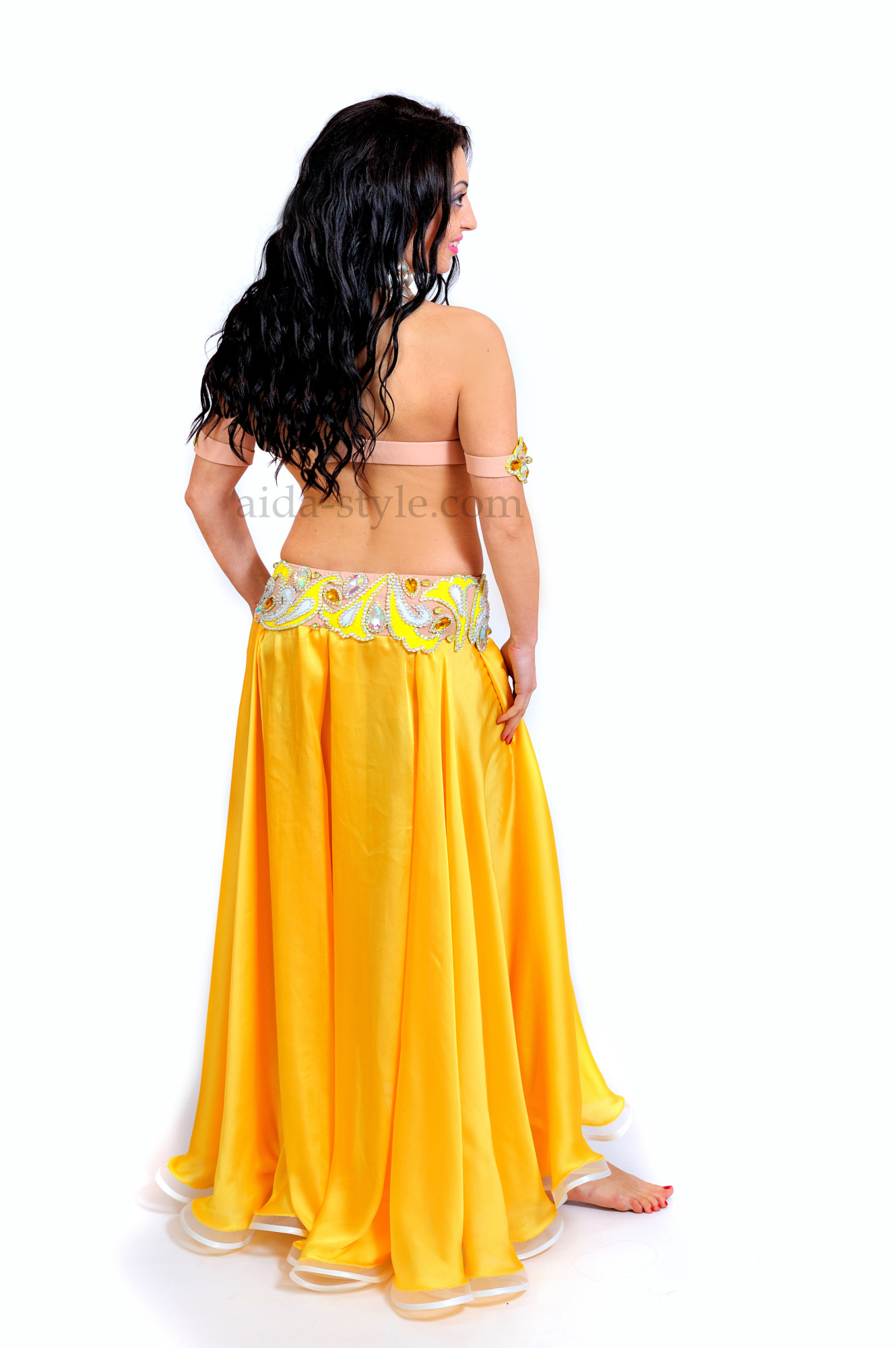 Bright yellow professional belly dance costume with belt and bra decorated with oriental patterns