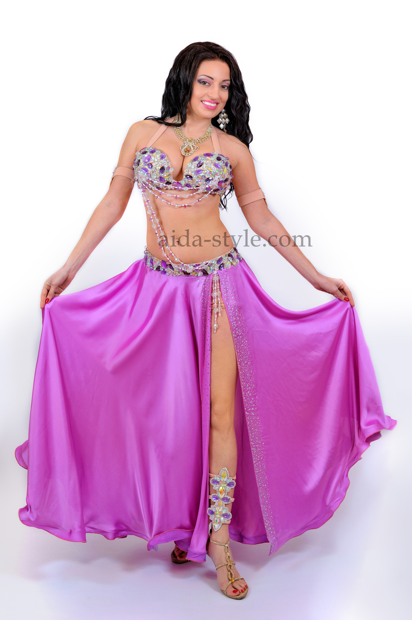Professional belly dance costume in lilac color with long bouffant skirt