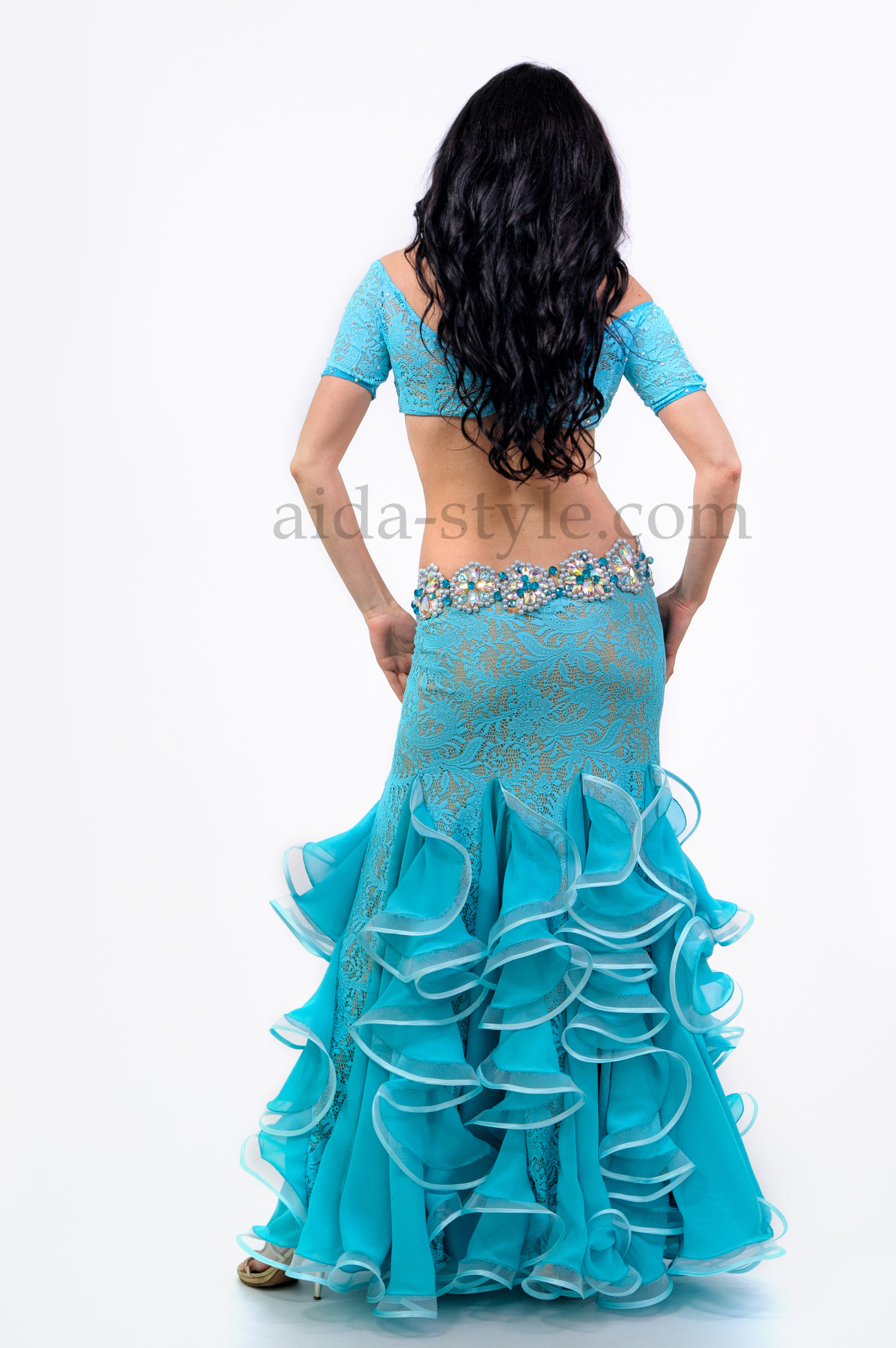 Beautiful blue professional belly dance dress with sleeves and ruffles on the skirt