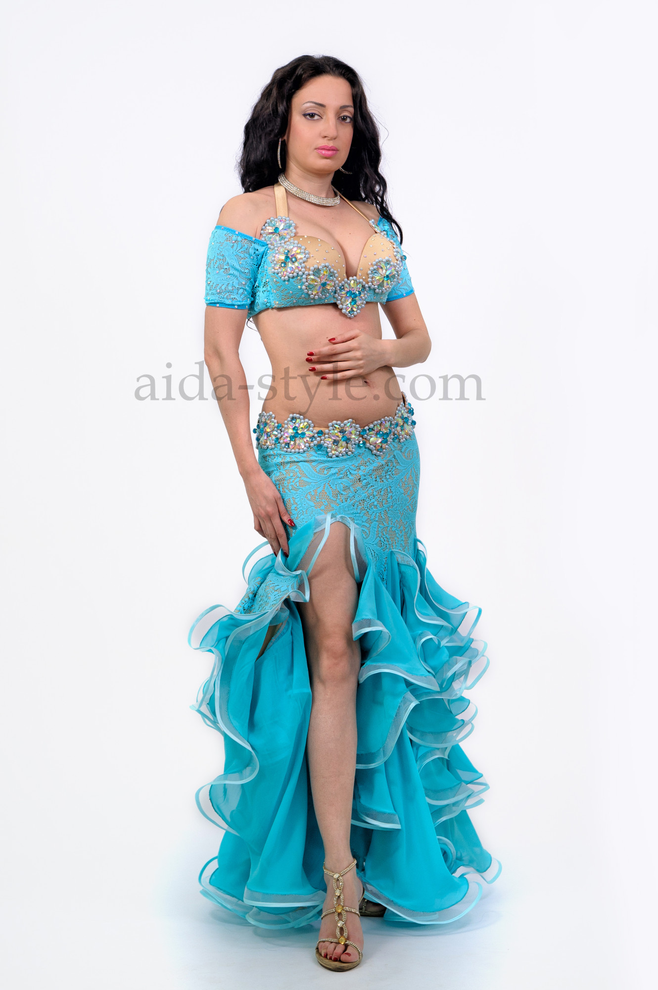 Beautiful blue professional belly dance dress with sleeves and ruffles on the skirt. The skirt has a cut on the right side