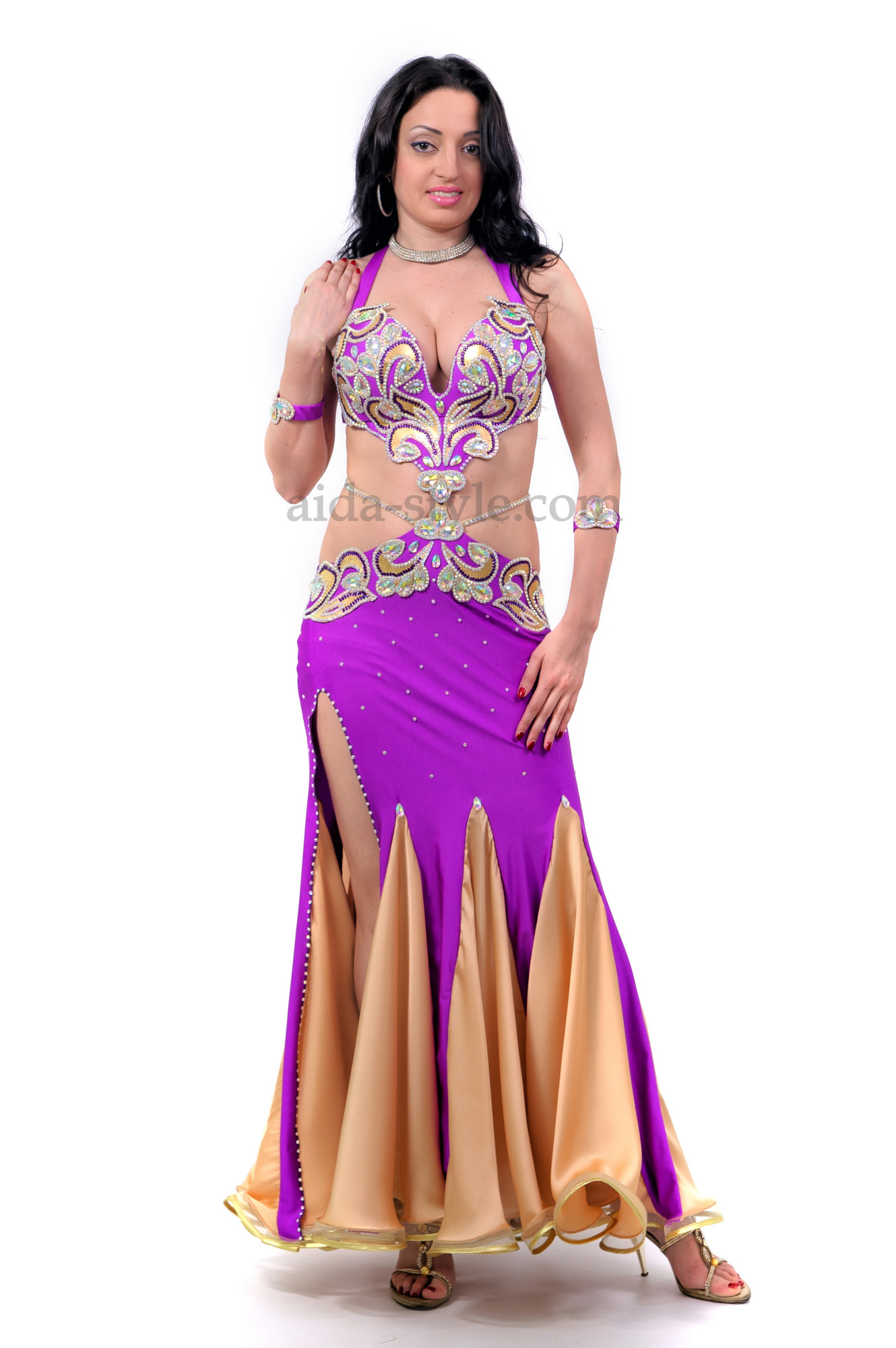 Professional belly dance dress in violet color and with a rich decoration from stones