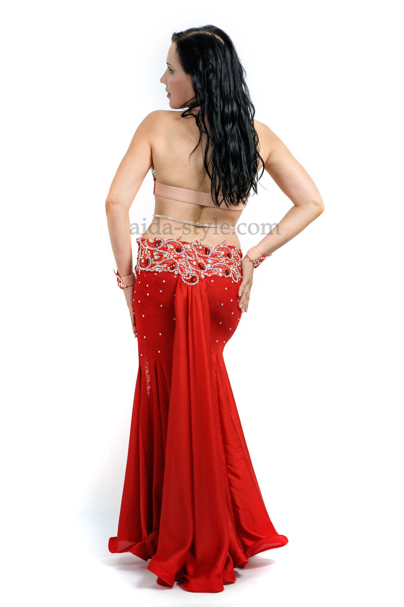 Red professional belly dance dress. The skirt has a cut on the left side. Both bra and skirt are decorated with stones