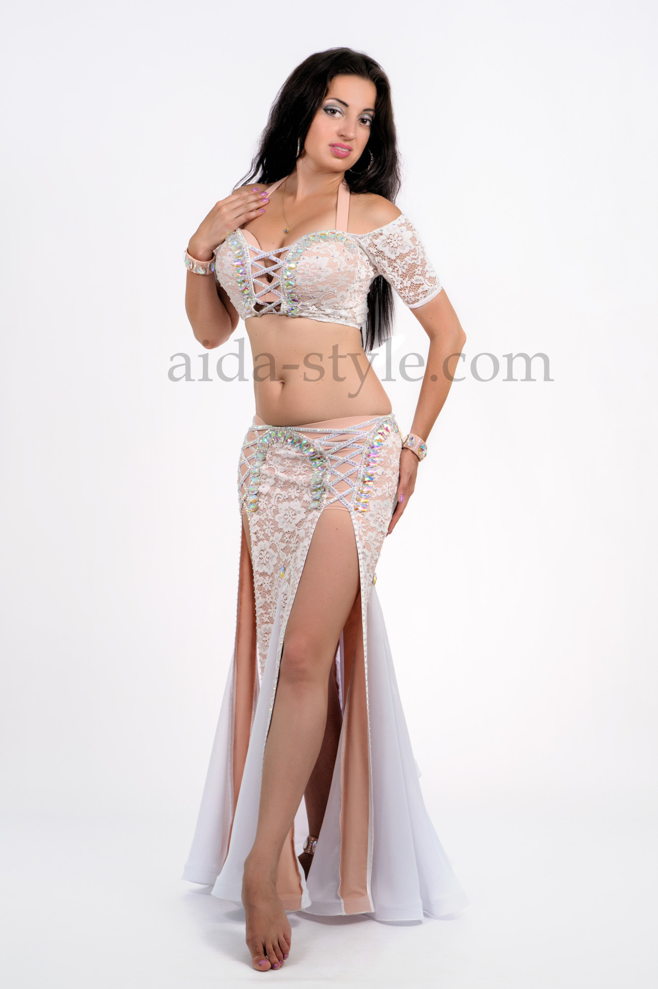 White professional belly dance costume, sewed with white fabric with beige underlayer