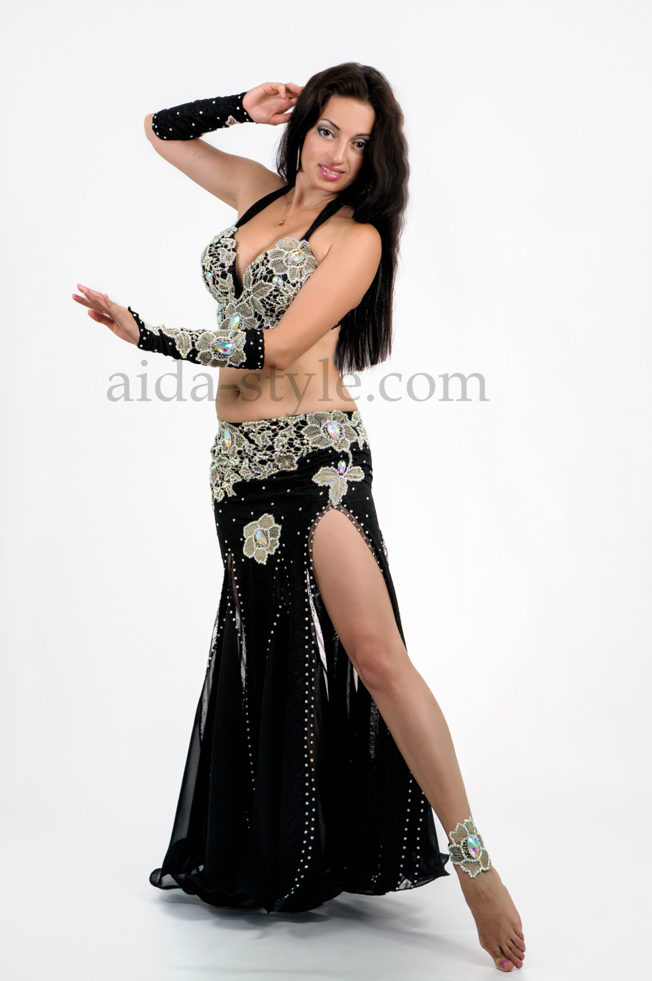 Beautiful and elegant professional belly dance costume for pros and amateurs. Black base is decorated with white lace patterns
