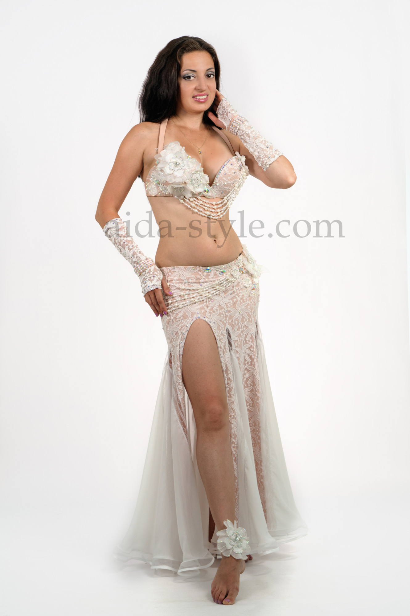 Professional belly dance dress. Skirt is from stretchable material. Bra is decorated with white artificial flowers
