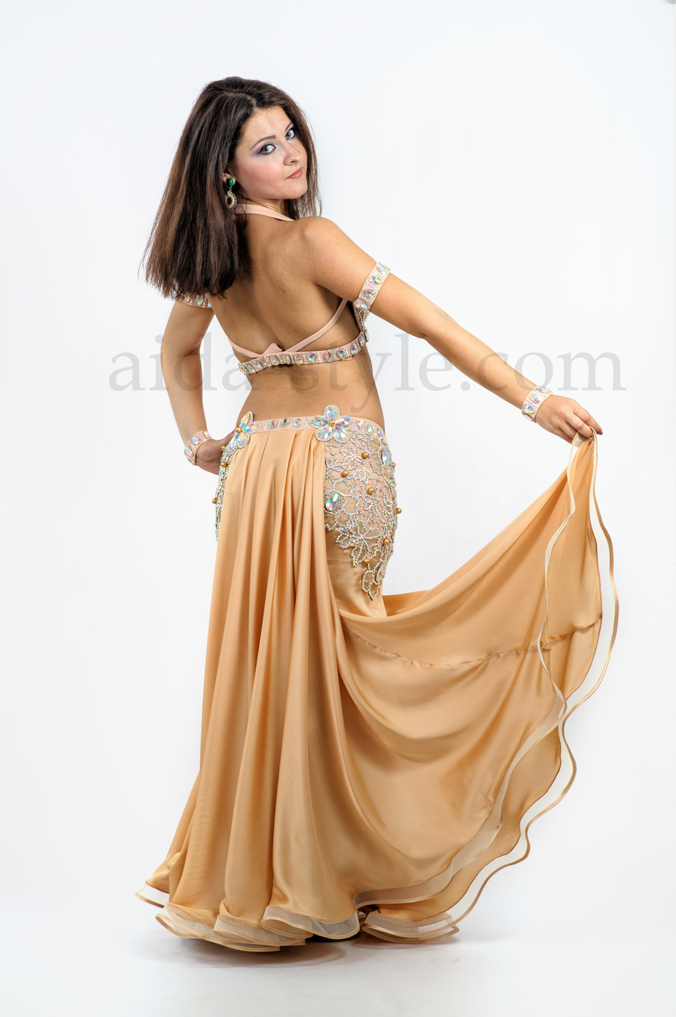 Golden custom made proffessional belly dance costume with rich decoration and a tail on the back