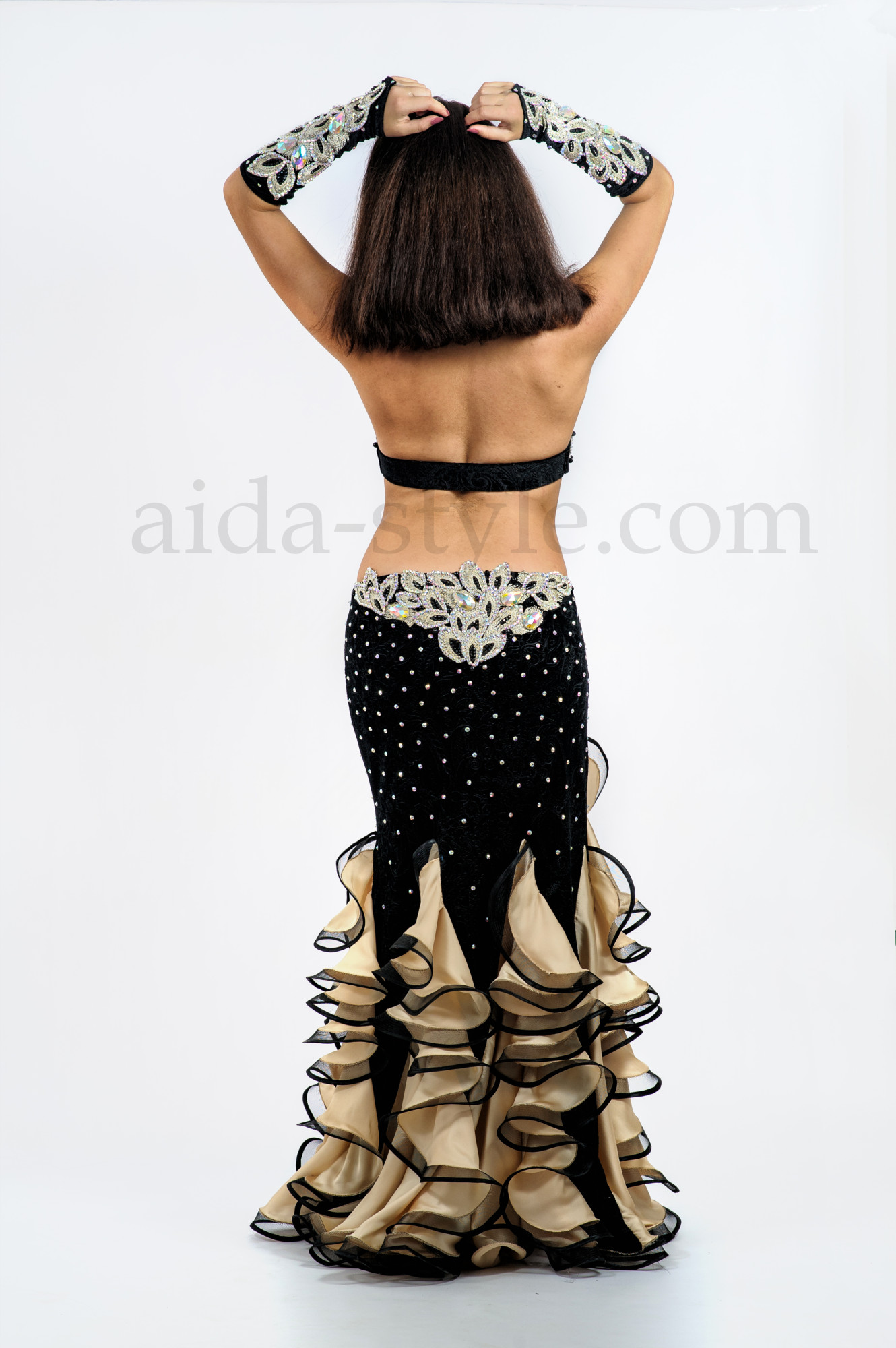 Black and golden custom made professional belly dance outfit with ruffles on the skirt