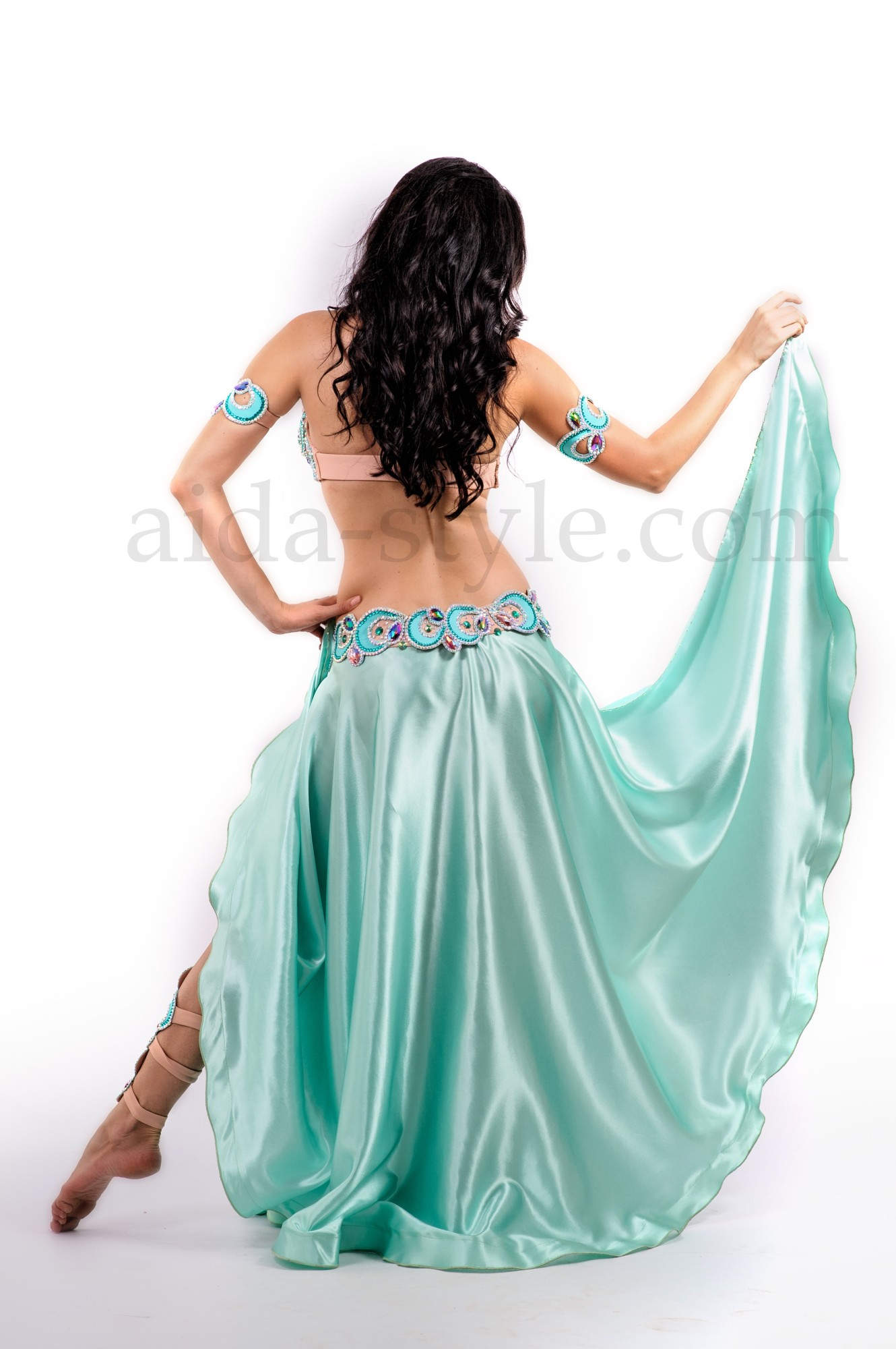 Professional belly dance costume in azure-blue color and turkish style decoration