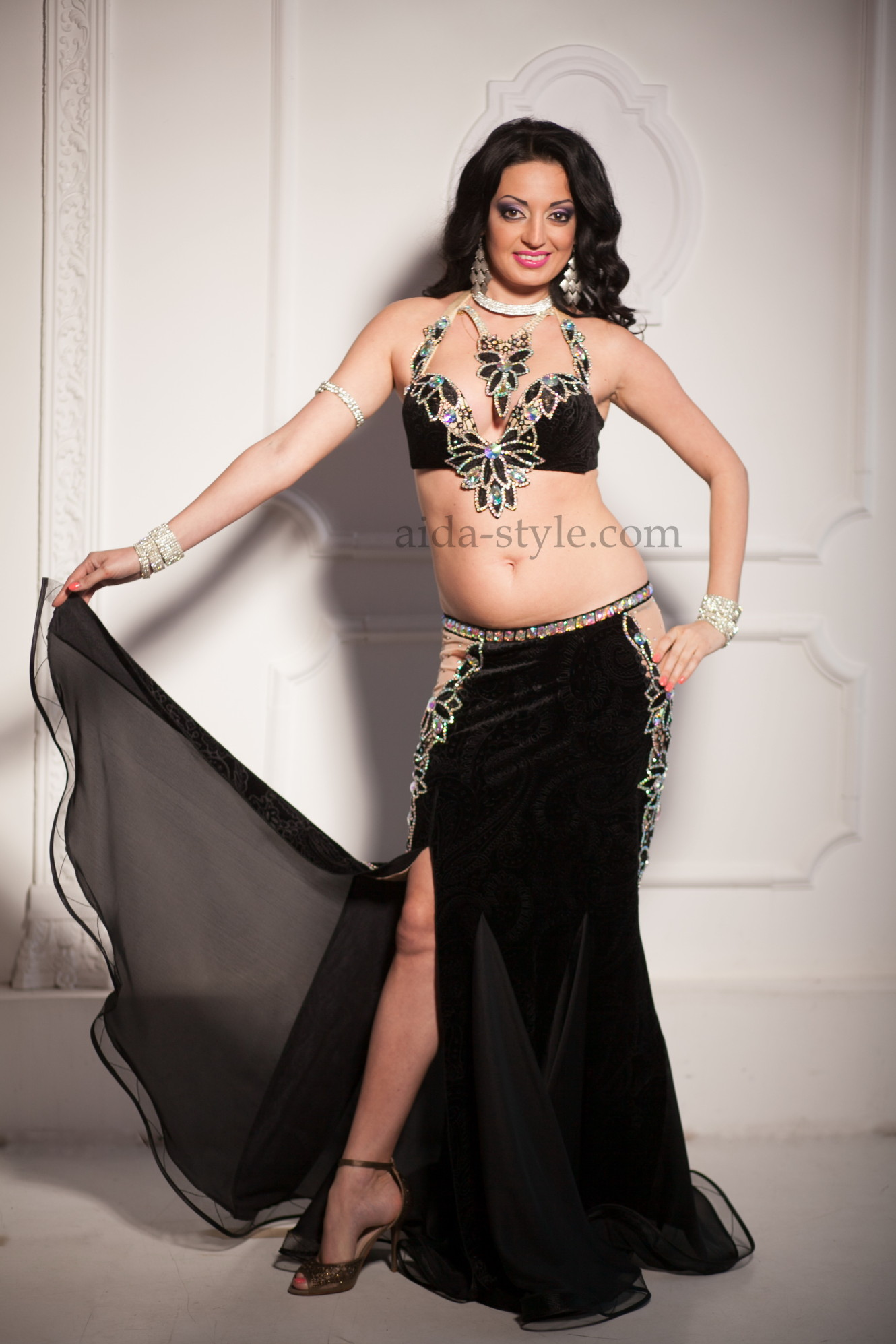 Professional belly dance costume with strip hips and richly decorated bra