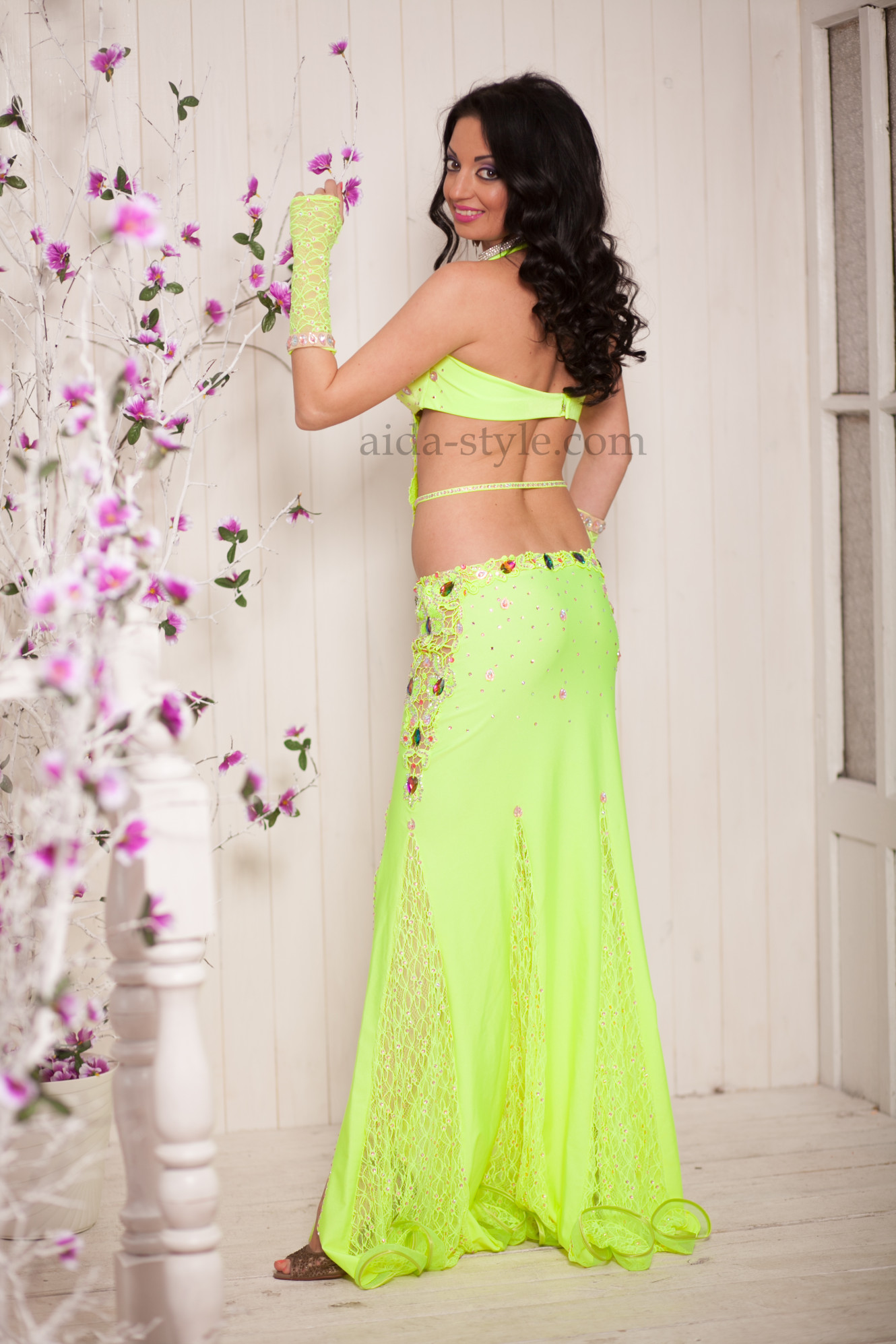 Professional belly dance costume in lemon color. The dress has a cut on the left side and a decoration that goes accross belly