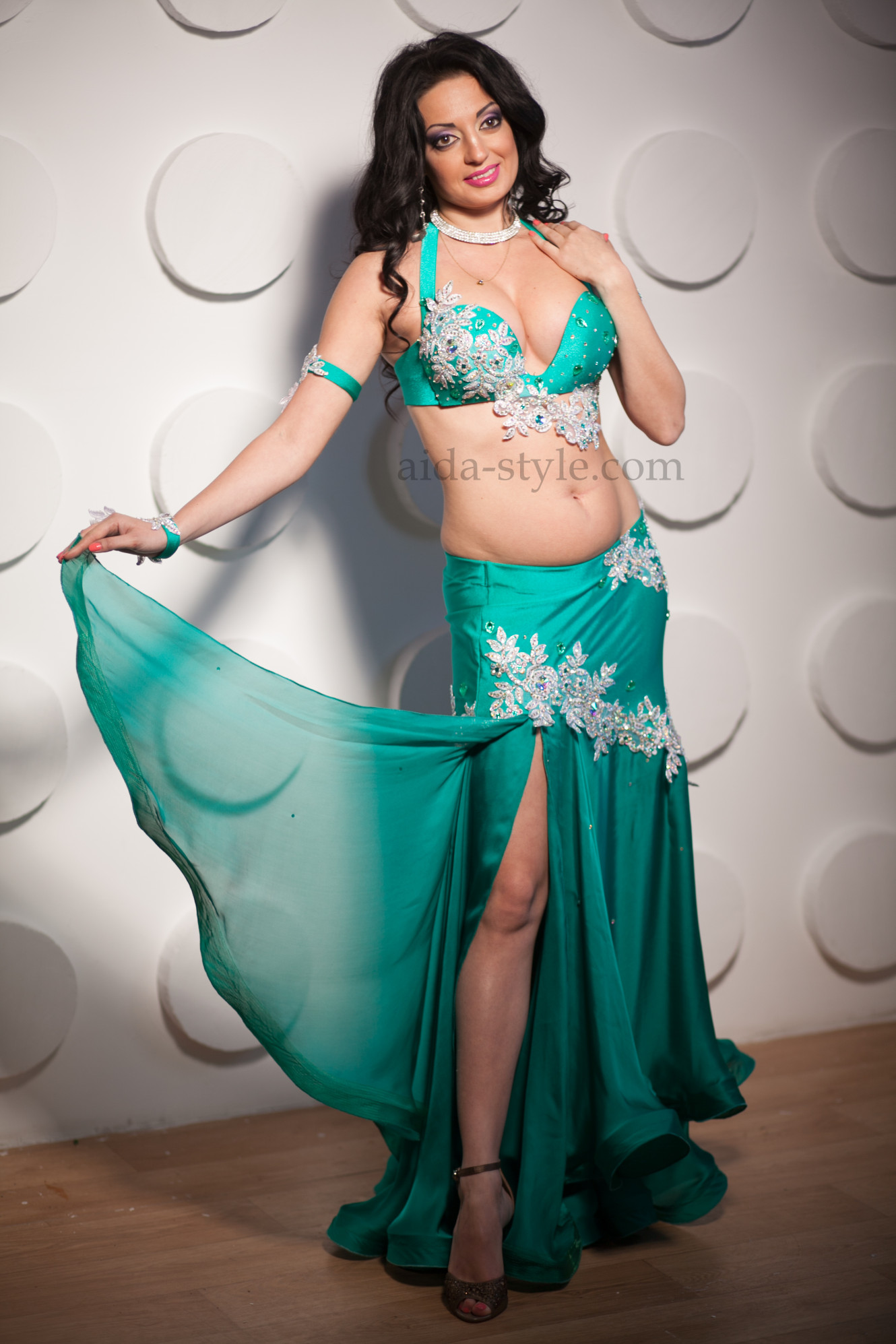 Blue professional belly dance costume with white decorations