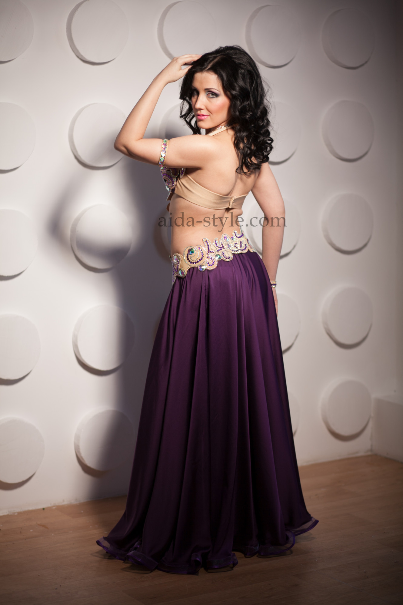 Professional belly dance costume in dark purple color. Bouffant skirt is made from light silky fabric. Belt and bra have bright shiny applications