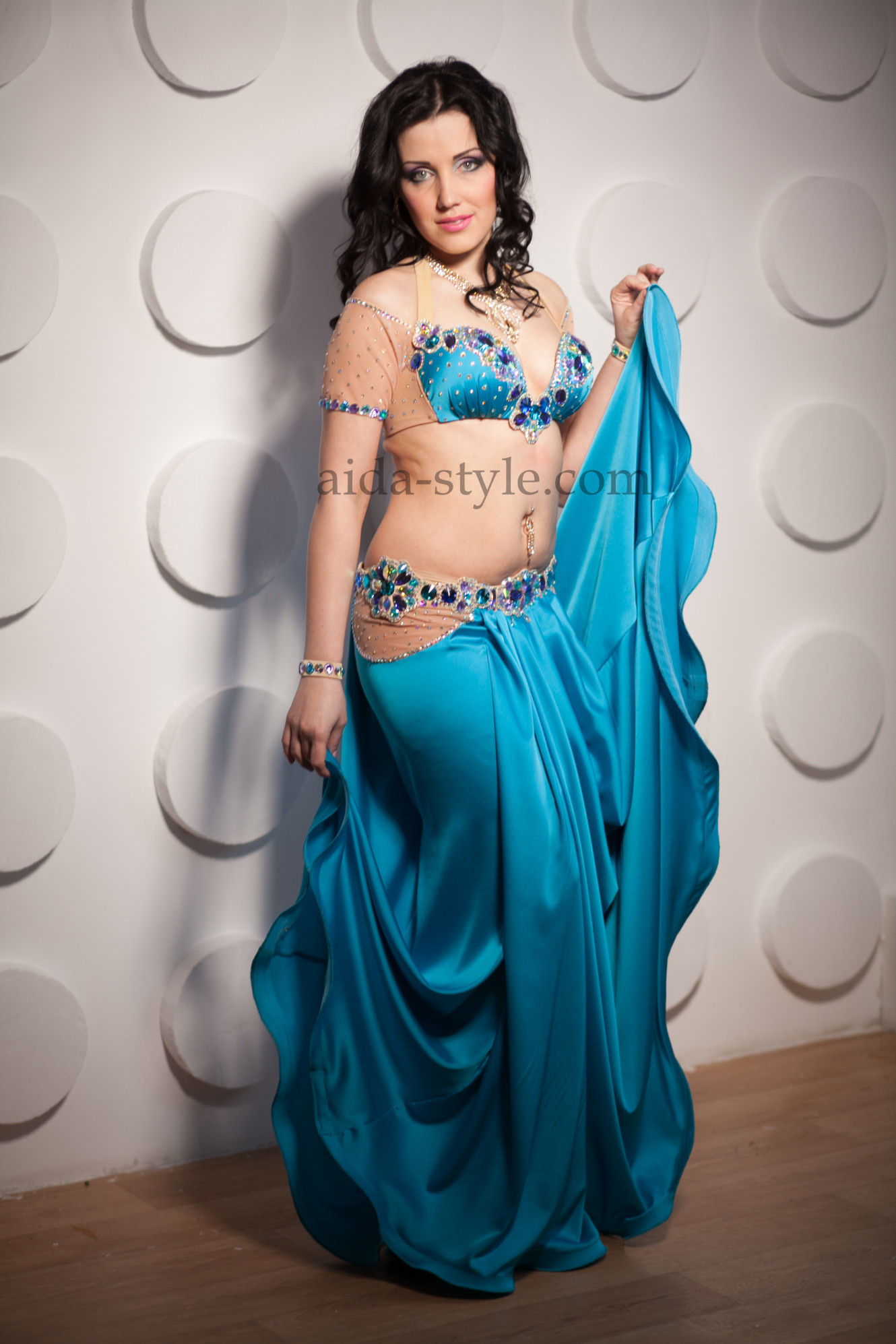 Blue professional belly dance costume with bright stones applied on bra and belt