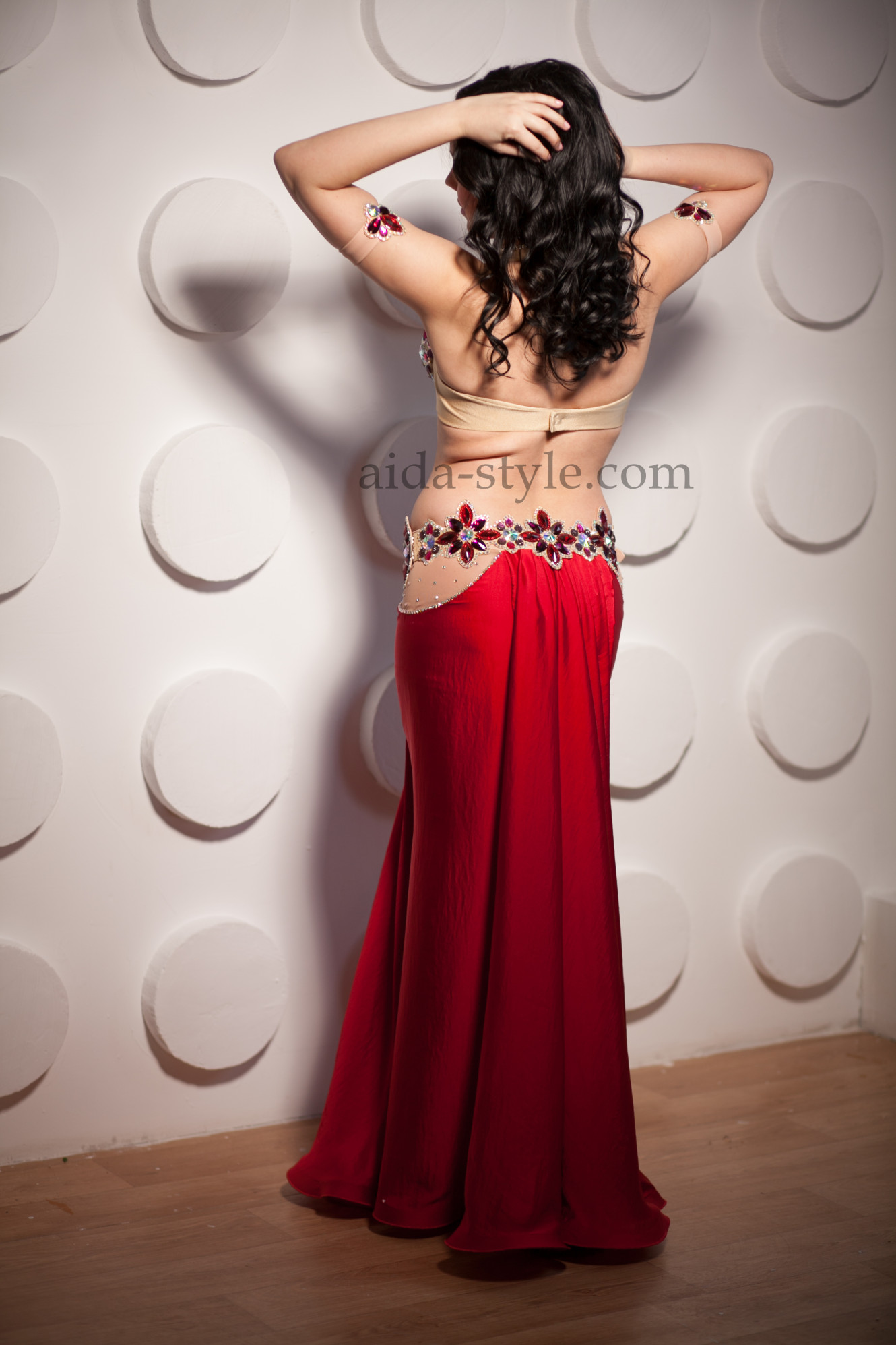 Professional belly dance costume with bright colored stones on bra and belt