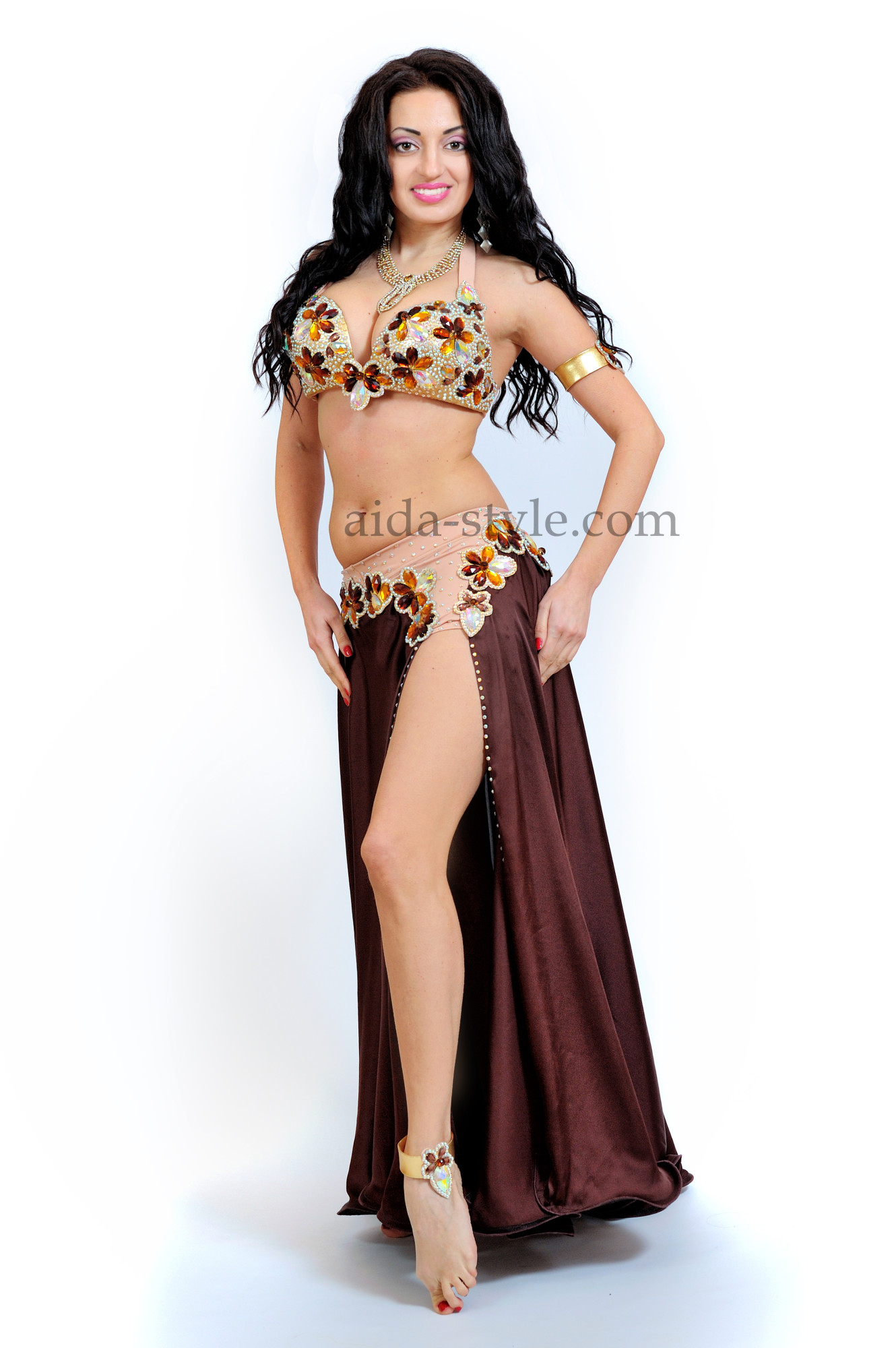 Beautiful brown professional belly dance costume decorated with golden stones