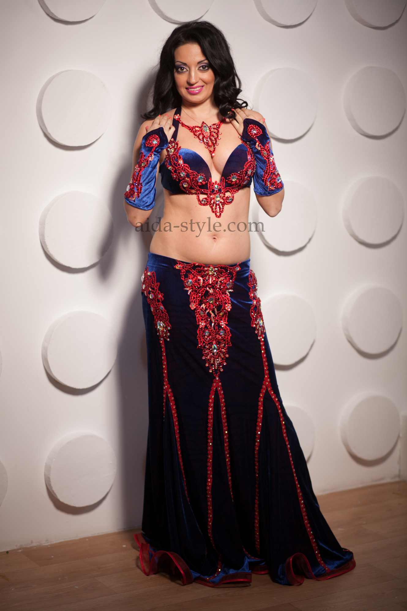 Professional belly dance costume in dark blue color with bordo flowers as an application