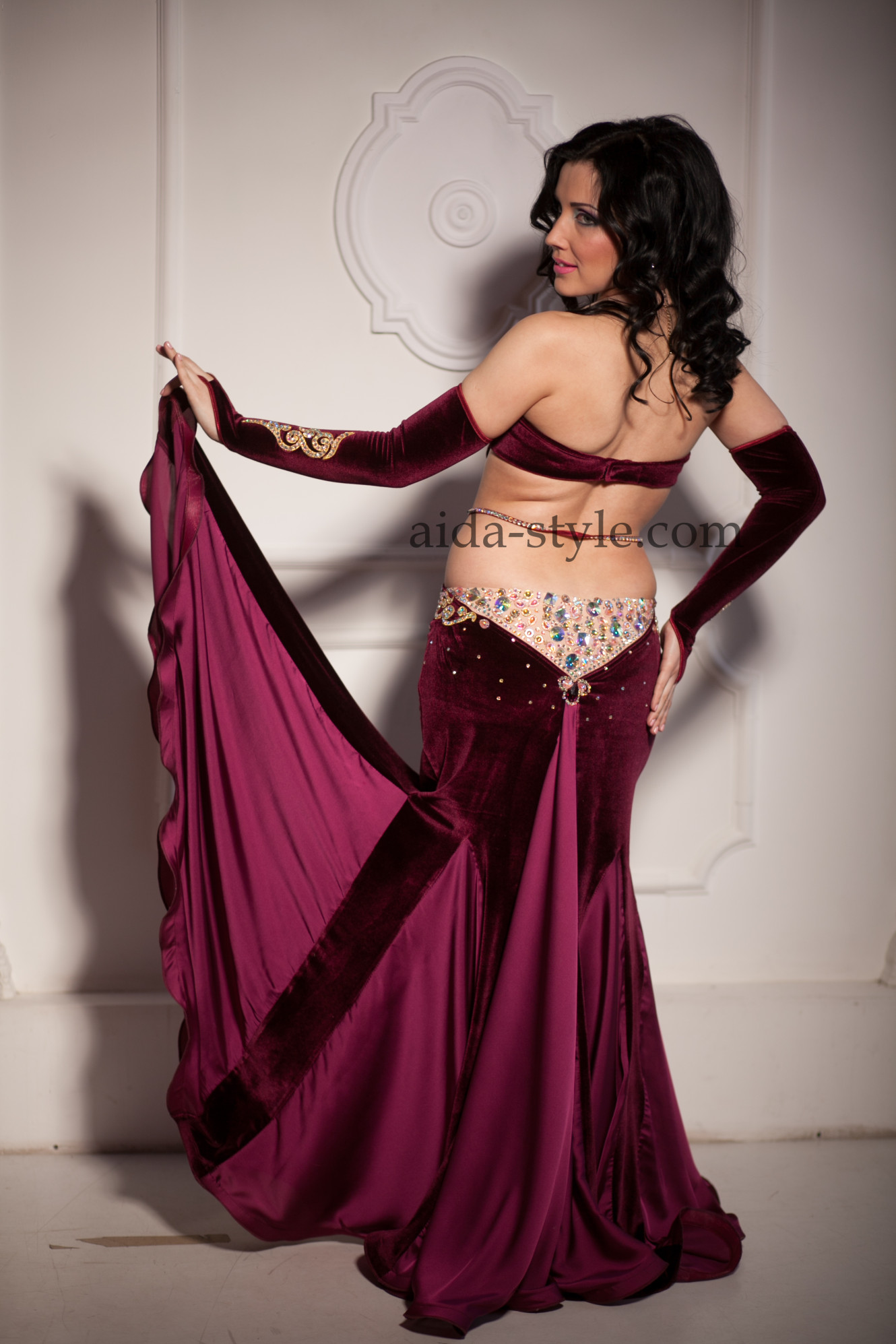 Professional belly dance dress made of two types of fabric. Has opera length gloves. Bra and belt are decorated with oriental patterns