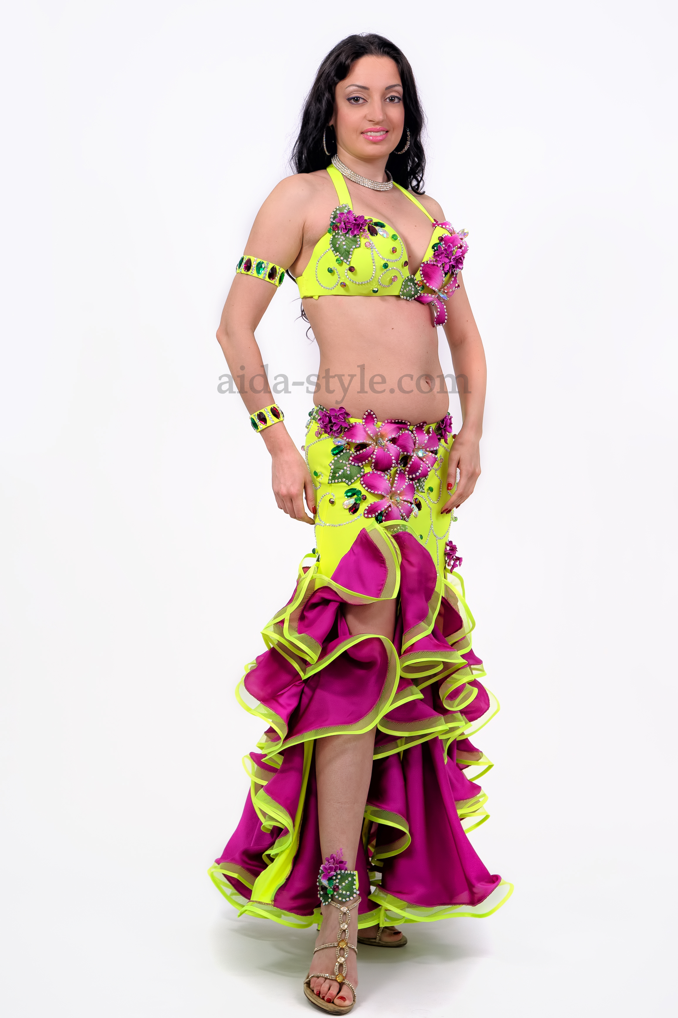 Professional belly dance dress. Violet color of artificial flowers match the color of flounces on the skirt. Th cut is on the right side