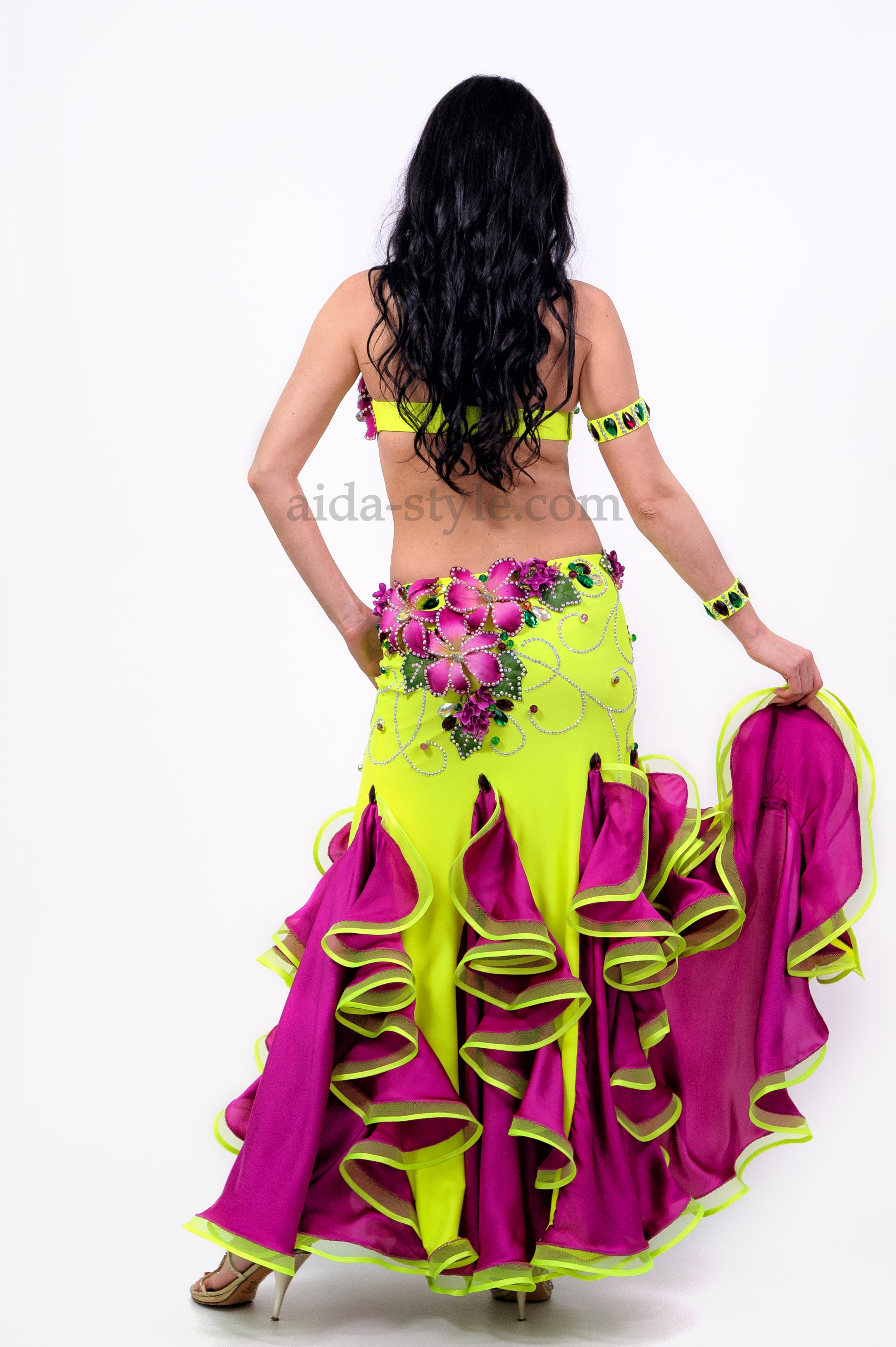 Professional belly dance dress. Violet color of artificial flowers match the color of flounces on the skirt. The dress comes together with hand accessories