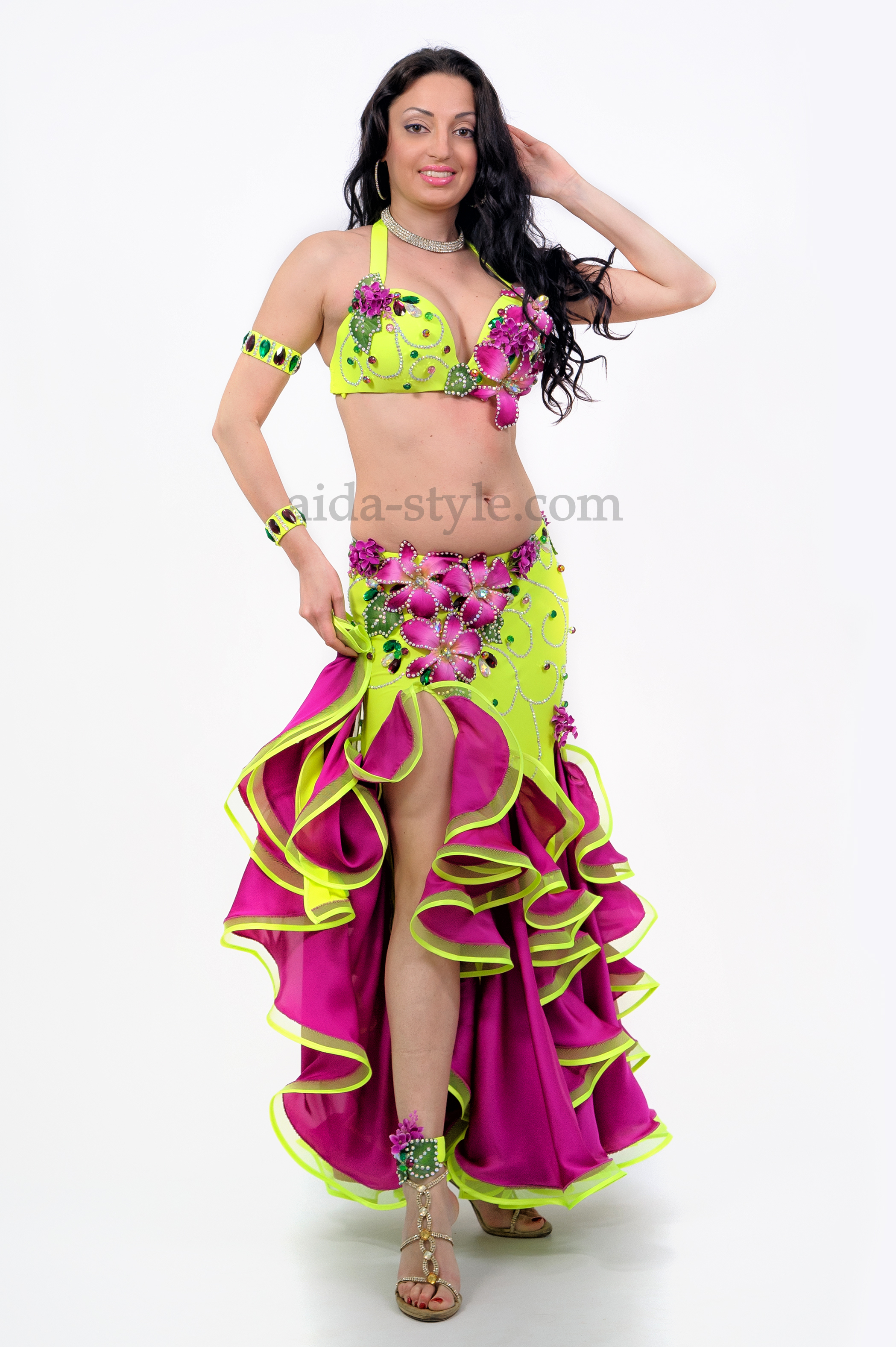 Two-colored professional belly dance dress, of chartreuse and violet colors. The skirt and bra are decorated with bright violet flowers