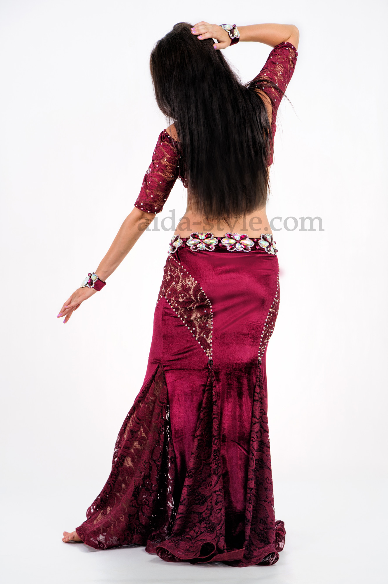 Elegant professional belly dance skin tight suit. Bra and belt are decorated with stones. Skirt has flounces