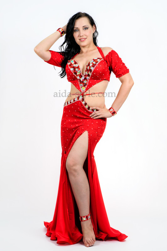 Bright red professional belly dance dress with a cut on the left side and belly decoration
