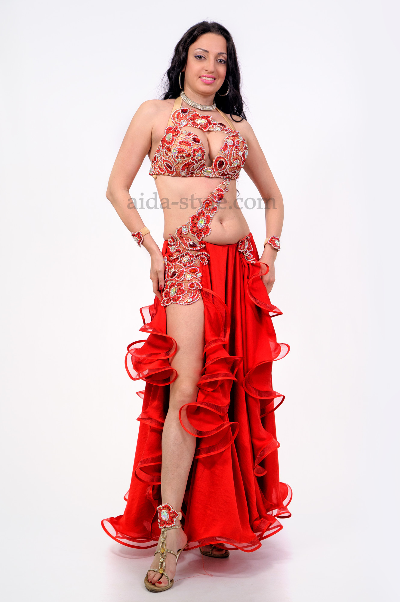 Professional belly dance dress decorated with artificial flowers and stones.