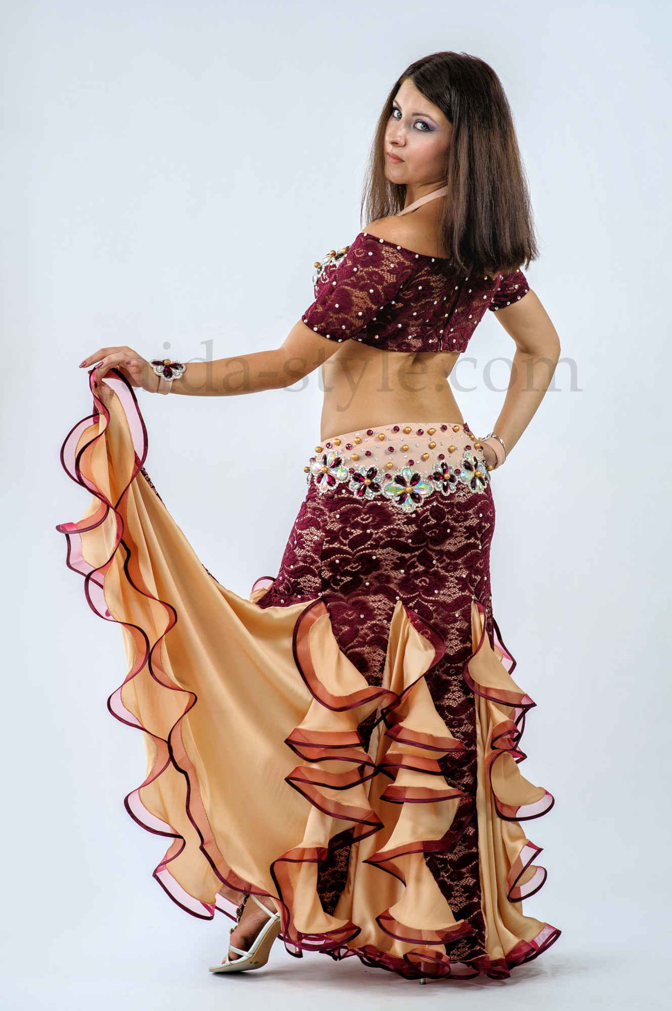 Professional belly dance costume in black and gold decorated with stones