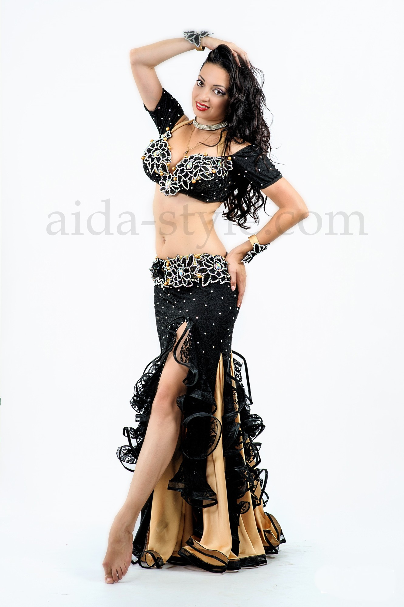 Black custom made professional belly dance outfit decorated with golden flounces