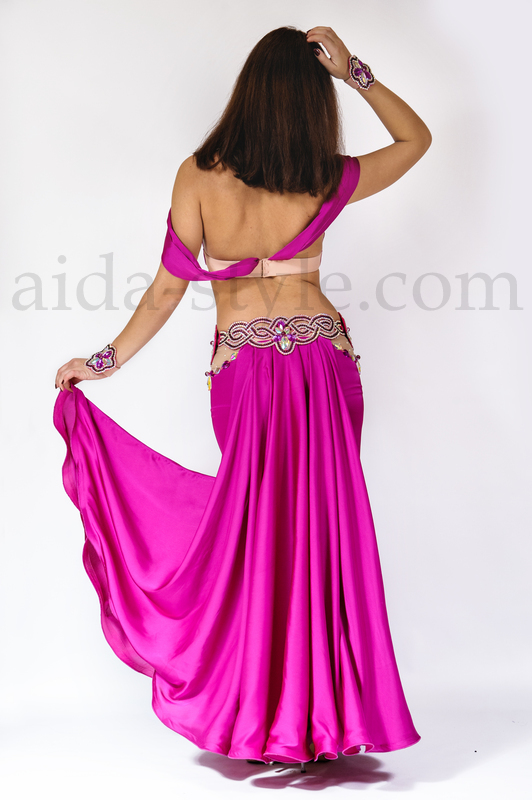 Bright fuchsia belly dance outfit. Belt is detouchable and connects to the skirt with pins. Bra straps and back holder are stretchable and elastic.