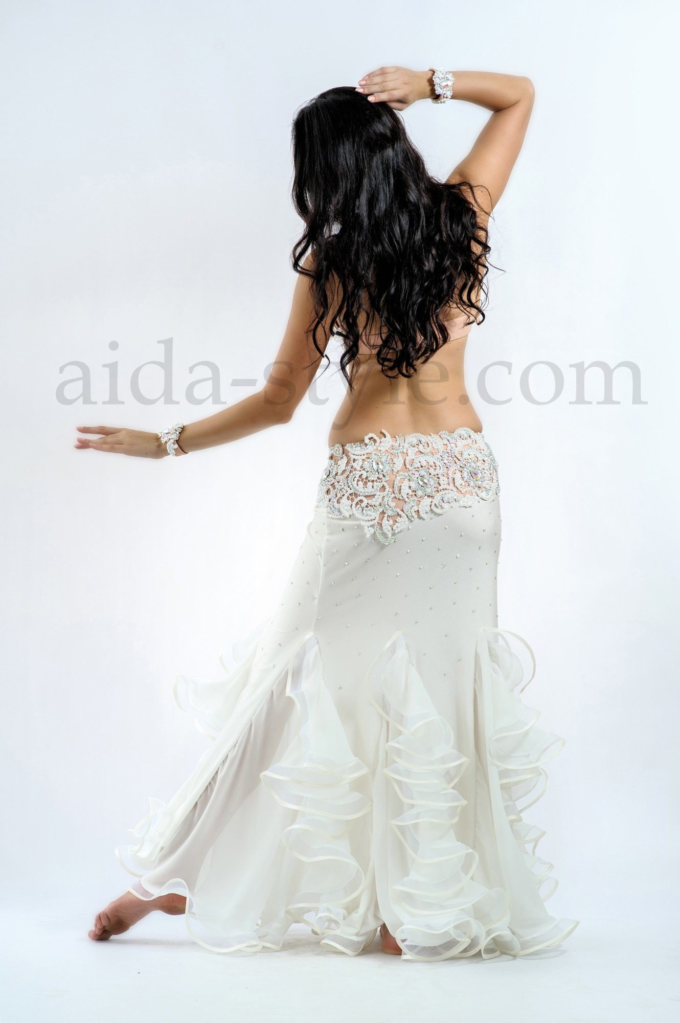 Pure white professional belly dance outfit decorated with ruffles