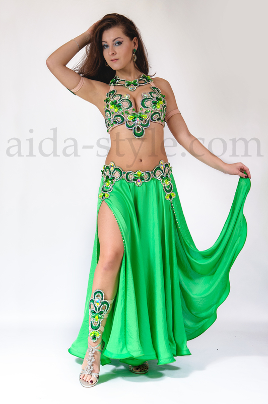 Beautiful emerald-green professional belly dance costume with lace decoration. Costume is very convenient. Bra stripes and back holder are stretchable. Belt is connected to the skirt. It is also elastic and stretchable.