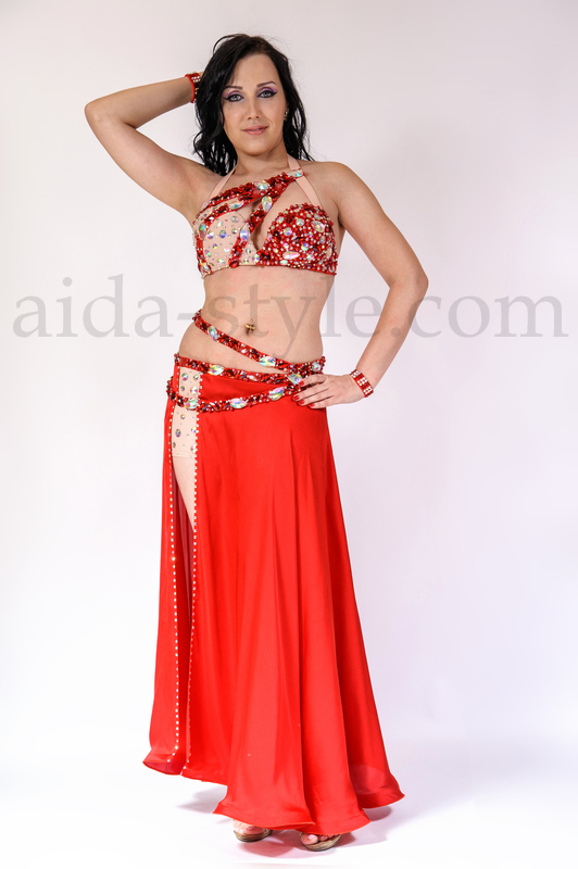 Exclusive professional belly dance outfit in bright red color - looks fantastic both on big and small stage. Perfect for full-time performers. Bra straps and back holder are elastic and stretchable. Tripple belt is aggregated with the skirt.