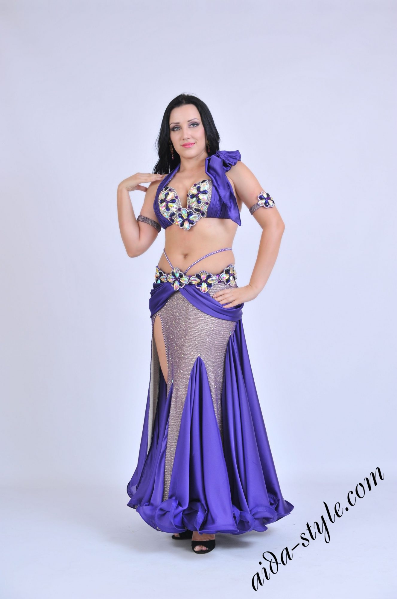 Purple belly dance outfit by Olga Aida with drapping that enhances hips dance