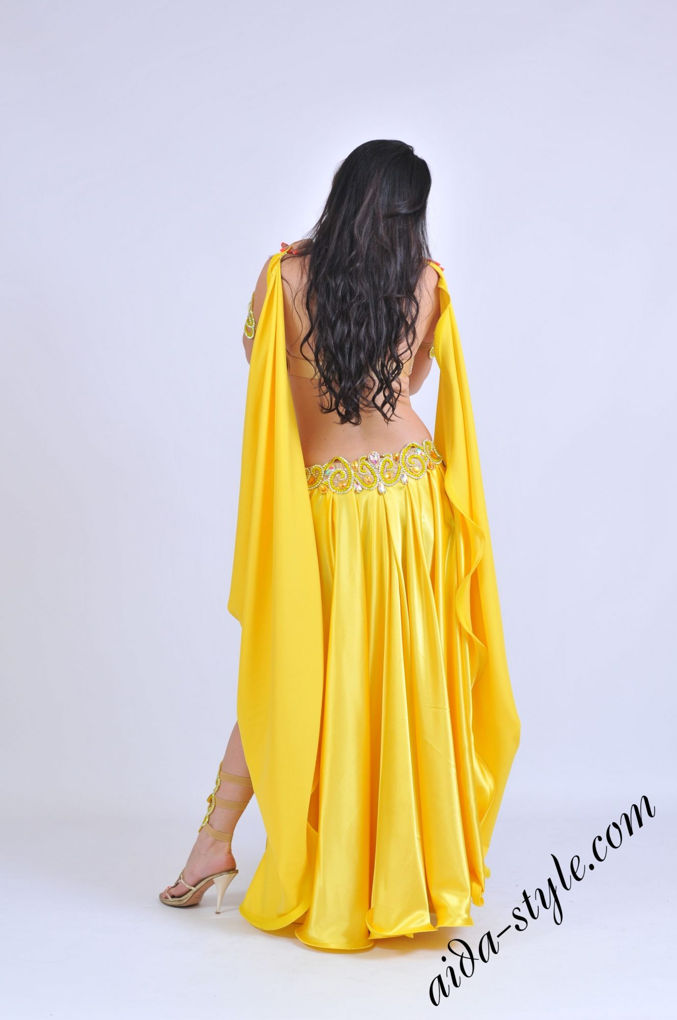 Yellow bellydance costume by Olga Aida with wide free skirt