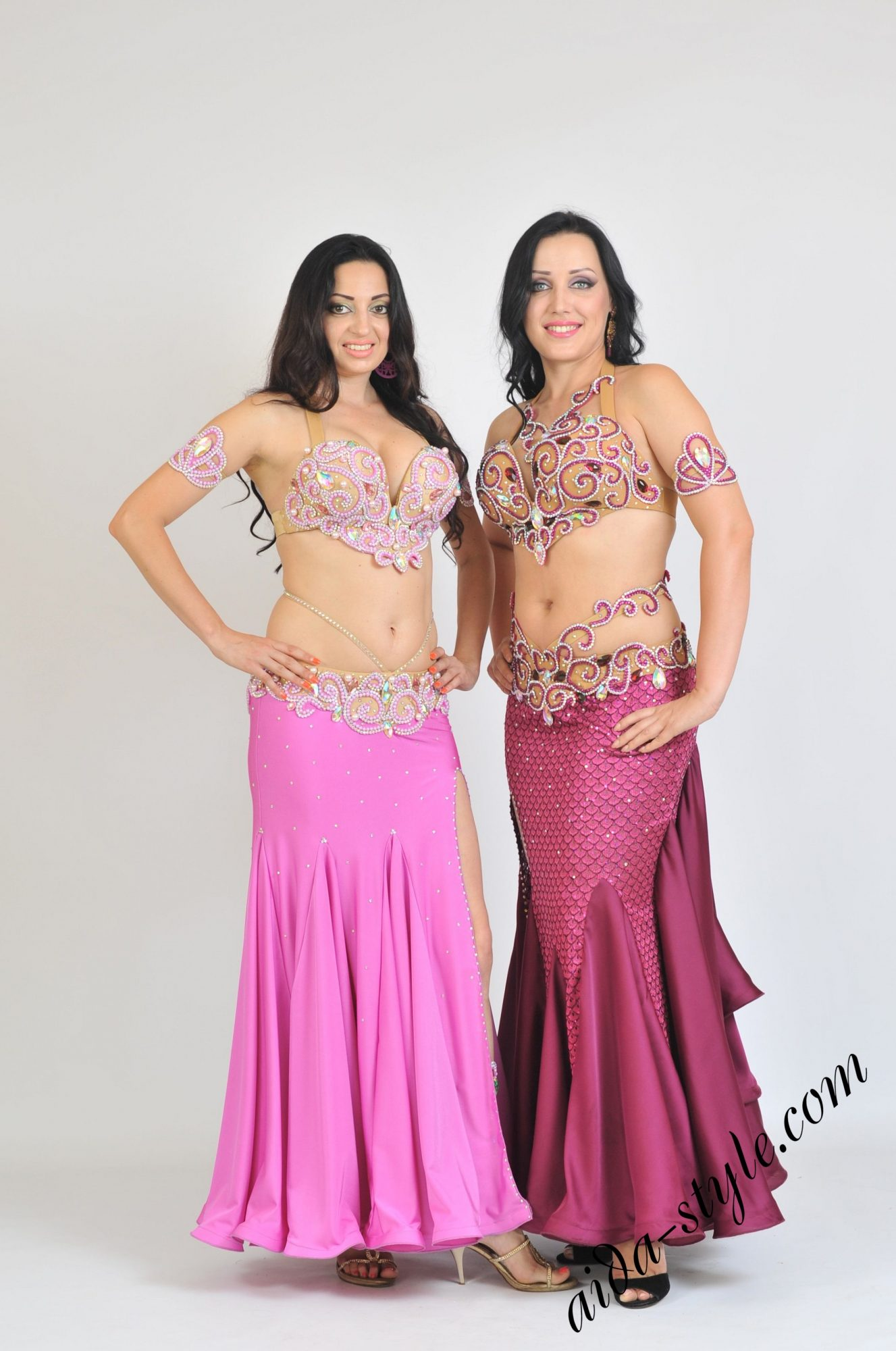 Pink and bordeaux bellydance costumes by Olga Aida