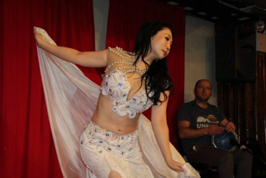 Yayoi Miller bellydancing in costume by Aida Style