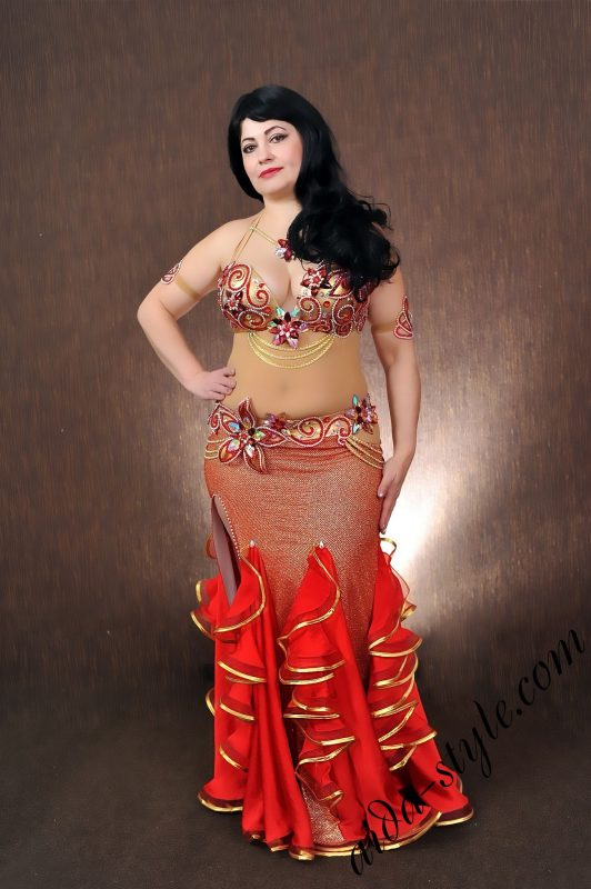 red designer's pro belly dance costume by Aida Style; consists from bra, belt, accessories and a skirt