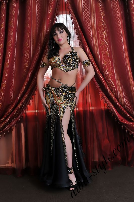 Black and golden belly dance outfit by Aida with mermaid skirt and graceful tail at the back of the skirt