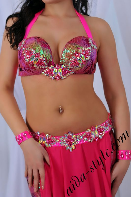 Pink belly dance costume by Aida with tight-flare skirt and detachable belt