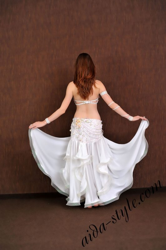 small white belly dance costume with wide circular skirt