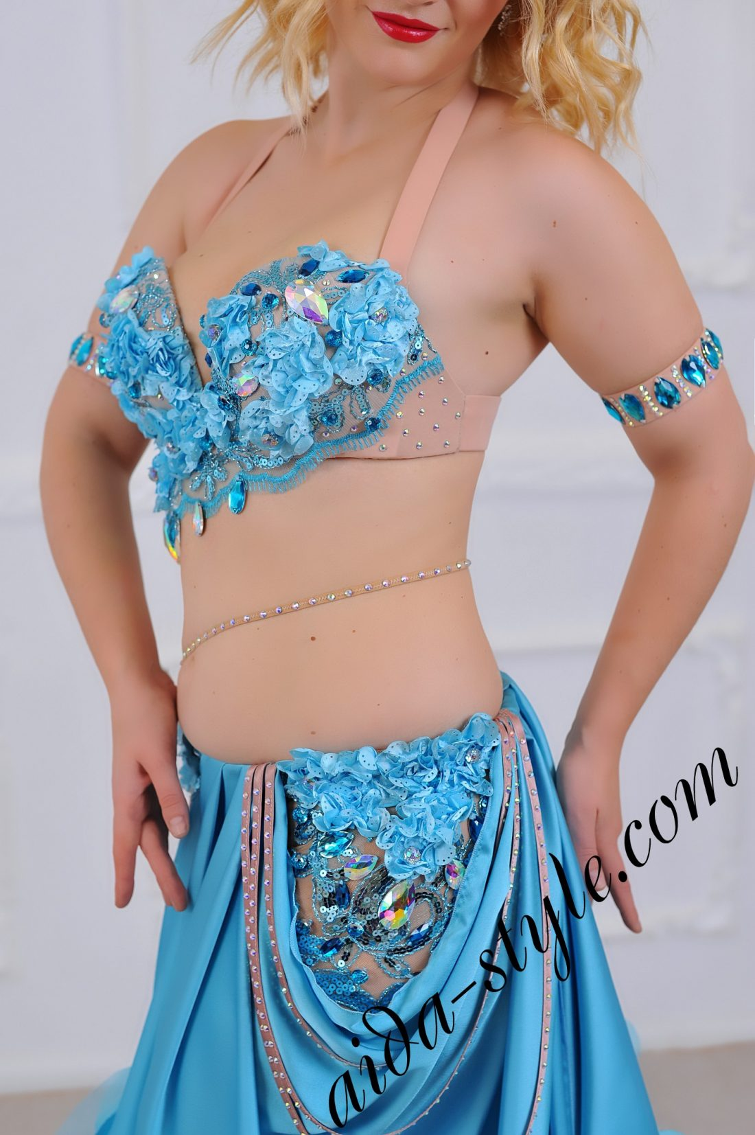 high quality blue pro belly dance costume with subtle and bouffant decorations and free flirty skirt