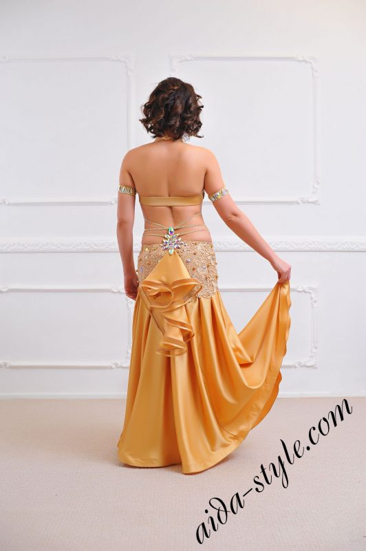 golden costume for belly dancing from designer with flare skirt by aida style